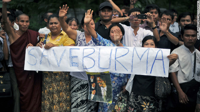 Local residents hold a banner advocating reforms during U.S. President Barack Obama's visit to Yangon on November 19.