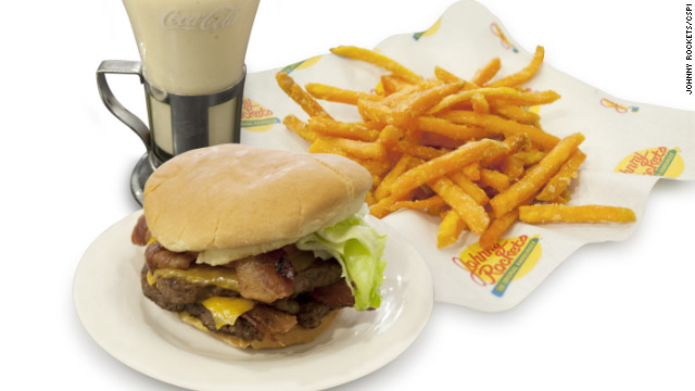 Where to start? The Johnny Rockets bacon cheddar double burger is 1,770 calories with its white bun, two beef patties, four cheese slices, four strips of bacon and a sauce. As a comparison, three McDonald's Quarter Pounders with cheese have 1,570 calories. Add Johnny Rockets' sweet potato fries for 590 calories and a Big Apple shake for a total calorie count of 3,500, with 88 grams of saturated fat and 15 teaspoons of added sugar. 