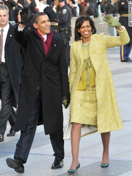 President Barack Obama and first lady Michelle Obama wave to the crowd at the 2009 inaugural parade.