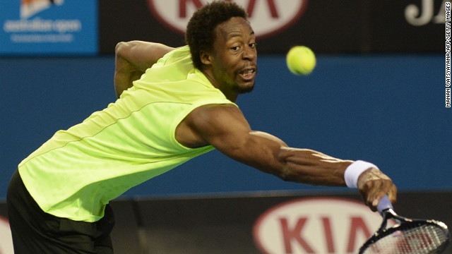 France's Gael Monfils reaches for a return during his men's singles match against Ukraine's Alexandr Dolgopolov on January 15. Monfils defeated Dolgopolov 6-7(7), 7-6(4), 6-3, 6-3.