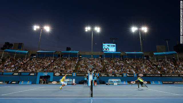 Monfils, right, plays a return to Dolgopolov during their singles match on January 15.