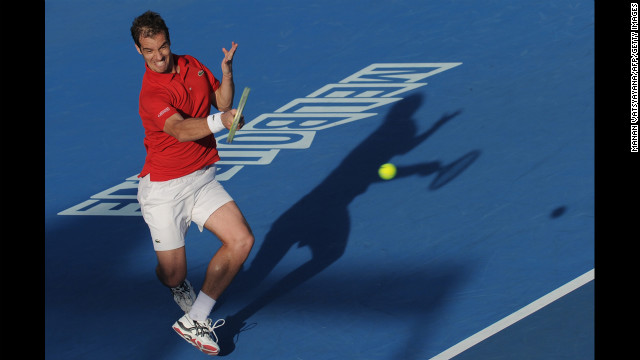 France's Richard Gasquet plays a return during his men's singles match against Albert Montanes of Spain on January 15. Gasquet defeated Montanes 7-5, 6-2, 6-1.