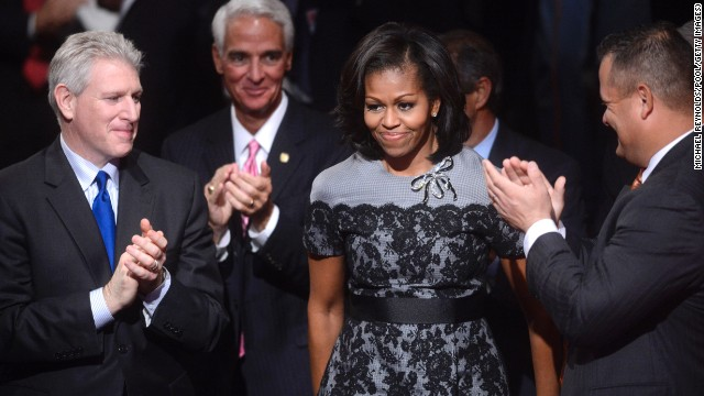 At the final 2012 presidential debate in Boca Raton, Florida, Obama donned the same Thom Browne fog gray dress with black lace overlay that she wore at the DNC, reworked this time with a black belt and a stone brooch, Taylor noted.