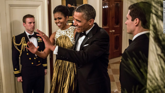 Obama greeted the audience at the Kennedy Center Honors in December in a striking gold lame gown by Michael Kors, according to Taylor.