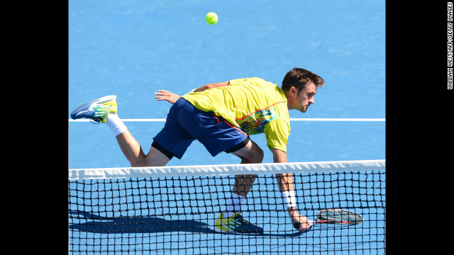 Tim Smyczek of the United States plays a return during his men's singles match against Spain's David Ferrer on January 16. Ferrer defeated Smyczek 6-0 7-5 4-6 6-3.