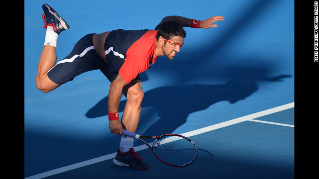 Serbia's Janko Tipsarevic hits a return against Slovakia's Lukas Lacko during their men's singles match on January 16. Tipsarevic won in five sets, 6-3, 6-4, 3-6, 4-6, 7-5.