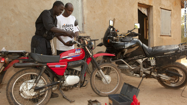 Saul Senghore, a RFH technician, provides a monthly service on Jallow's motorcycle. RFH employs local mechanics to regularly check all the vehicles it manages .