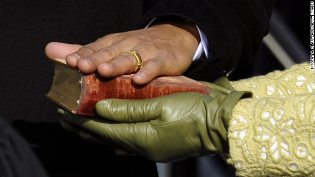 Barack Obama's hand lies on a Bible held by Michelle Obama as he is sworn in as the 44th U.S. president on January 20, 2009. 
