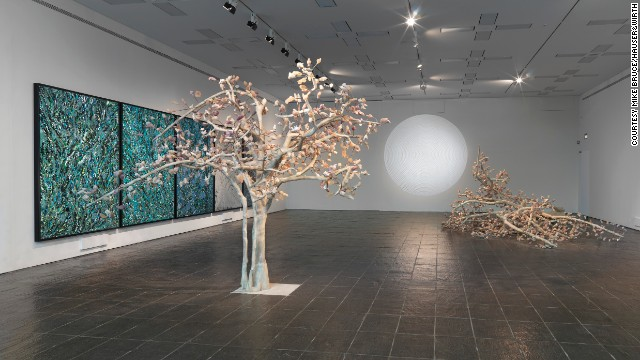 "Kher admits to being inspired by the macabre and loves the idea of combining it with traditional beauty. In her ""Solarum Series""<i> </i>(2007), her trees have autumnal leaves, which upon closer inspection are sculpted animal heads."