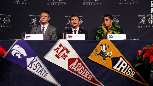 Heisman finalists quarterback Collin Klein, left, of the Kansas State Wildcats, quarterback Johnny Manziel, center, of the Texas A&amp;amp;M University Aggies and linebacker Te'o speak during a news conference before the 78th Heisman Trophy Presentation at the Marriott Marquis on December 8, 2012, in New York City.