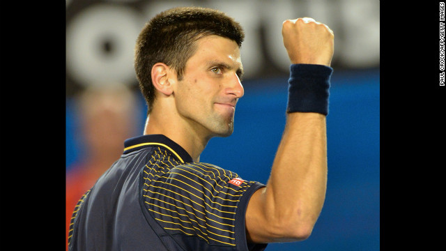 Djokovic gestures to the crowd as he celebrates victory over Harrison on January 16.