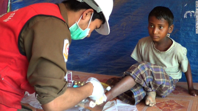 Faranarli, 14, visits the Red Cross clinic in the camp