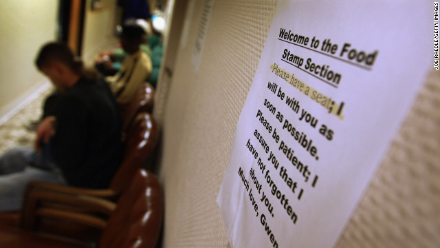 People wait to apply for the federal food stamps program in Fort Lauderdale, Florida.