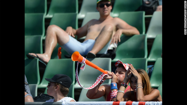 Spectators cheer for Croatia's Marin Cilic during his men's singles match against Rajeev Ram of the U.S. on January 17. Cilic won 7-5, 6-2, 6-4.