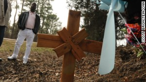 Donny Butts stands on a Mississippi roadside where his father was killed by a white teen driver.
