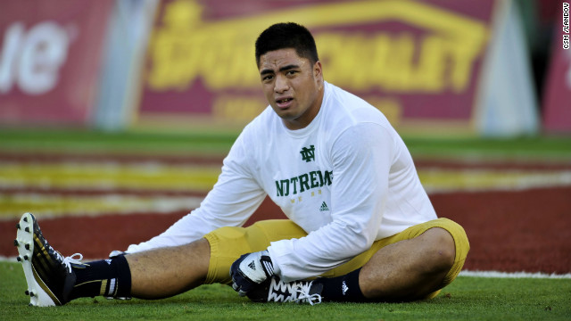Te'o stretches on November 24, when the Fighting Irish defeated the USC Trojans 22-13 in Los Angeles.