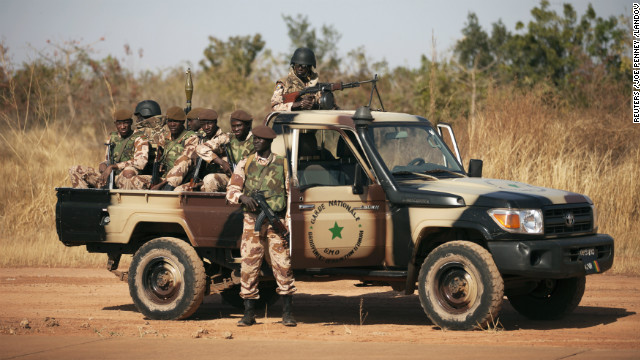 Malian soldiers stand guard as Mali's President Dioncounda Traore speaks to French troops at an air base in Bamako, Mali, on Wednesday, January 16.