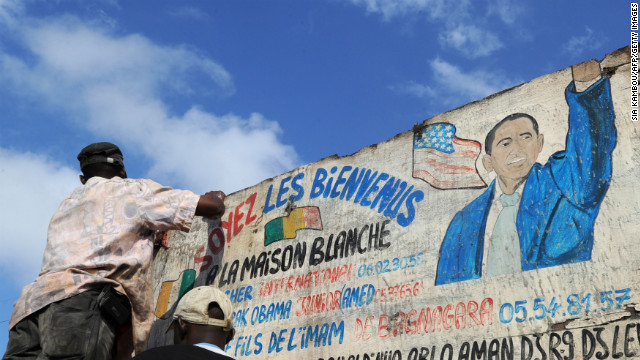 "IVORY COAST: A man washes the sign of a butchery named ""Maison Blanche"" (White House) in Abidjan on November 7, 2012."