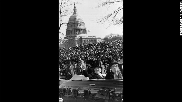 President Harry S. Truman waves to the crowd from a car during a parade after his inauguration speech on January 20, 1949.