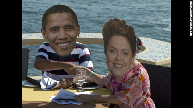 MEXICO: Members of the international organization OXFAM wear masks of Obama and Brazilian President Dilma Rousseff during a protest in Baja California on the eve of the G-20 summit on June 17, 2012.