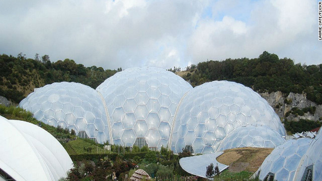"Taking nearly six years between concept and opening, the ambitious <a href='http://www.edenproject.com ' target='_blank'>Eden Project</a> opened to the public in March 2001. The attraction features two immense plastic and steel enclosures that emulate natural biomes and house thousands of plant species. <!-- --> </br><!-- --> </br>In the last decade, the complex has hosted concerts, marathons and weddings. The addition of a sustainable education center, a giant ""robot"" made from scrap electronics and, more recently, a ""rainforest lookout"" aerial tower, have all contributed to Eden's popularity. <!-- --> </br>(Image: Courtesy Lawrie Cate)"
