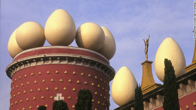 "Built in 1974 on the site of the town's former theater, this <a href='http://www.salvador-dali.org/museus/figueres/en_index.html ' target='_blank'>inventive building</a> holds the world's largest collection of Salvador Dali artwork. <!-- --> </br><!-- --> </br>Those not familiar with the surrealist artist's work might think that the large egg sculptures perched atop a dome and surrounding brick ""castle"" might just be a gimmick. Once inside, however, you realize the flamboyant façade pales in comparison to the wacky curiosities awaiting visitors. <!-- --> </br><!-- --> </br>More than 20 years after Dali's death, Figueres -- the town where he was born and later died -- continues to honor the eccentric master with a crypt containing his grave in the center of the museum."