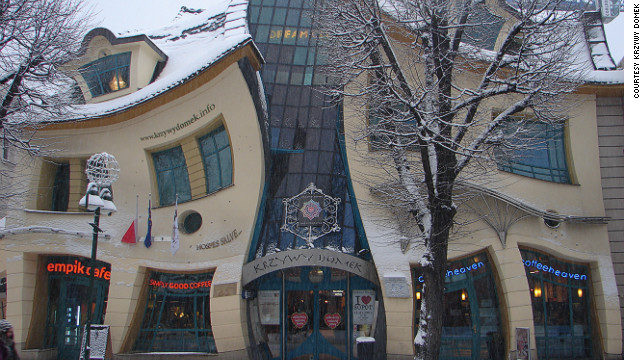 "Known as the ""Crooked House,"" this cartoon-like edifice houses a mall, restaurants and office buildings. <!-- --> </br><!-- --> </br>Built in 2004 by the design team of Szotyńscy & Zaleski, this whimsical building is said to have been inspired by the work of two distinguished Polish artists, illustrator Jan Marcin Szancer and children's literature author Jan Brzechwa. <!-- --> </br><!-- --> </br><a href='http://krzywydomek.info/home-page.html ' target='_blank'>Krzywy Domek</a> has become so popular with visitors that an interior wall has been designated as a ""wall of fame"" where participants of cultural events are asked to autograph their names."