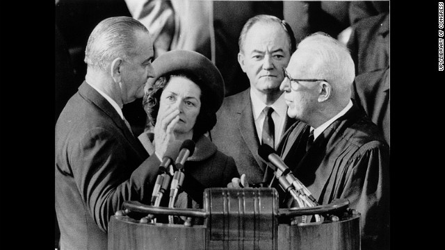 Lyndon B. Johnson, left, is sworn in for his second term by Chief Justice Earl Warren on January 20, 1965.
