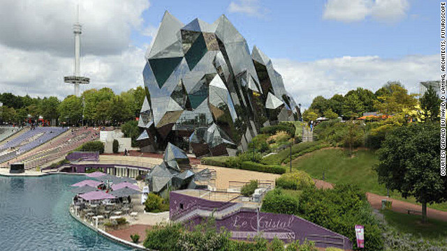 Symbolizing rock crystals thrusting out of the earth, this alluring building is one of the original pavilions created for the unique leisure park, <a href='http://en.futuroscope.com/' target='_blank'>Futuroscope</a>. <!-- --> </br><!-- --> </br>It houses one of the park's many IMAX theaters -- with a screen measuring 6,458 square feet (the size of two tennis courts) and a 440-seat capacity. Great care was taken before the creation of this architectural marvel; a large-scale Plexiglas model was built using 3,000 plates -- thousands of hours were spent calculating its complex angles on computerized simulators. Even maintenance requires special skills. All window cleaners are required to be professional mountaineers.<!-- --> </br>(Image: Courtesy Gerald Buthaud, D Laming, Architects, Futuroscope)