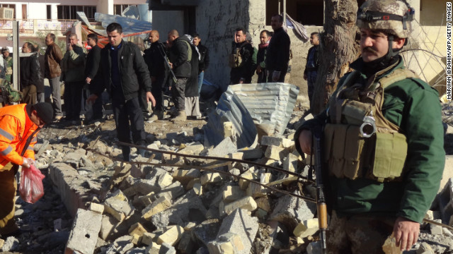 Iraqis inspect the site of an explosion on January 16, 2013 in Kirkuk.