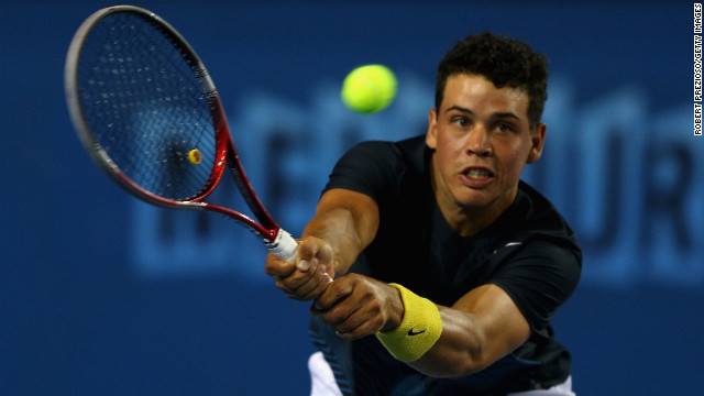 Alex Bolt of Australia plays a backhand in his third-round doubles match with Greg Jones of Australia against Daniele Bracciali of Italy and Lukas Dlouhy of Czech Republic on January 18. Bracciali and Dlouhy won 6-2, 7-6 (4).