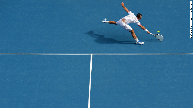 Stepanek hits a return against Djokovic during their men's singles match on January 18.
