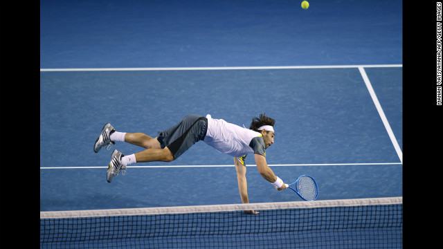 Marcos Baghdatis of Cyprus hits a return against David Ferrer of Spain during their men's singles match on January 18. Ferrer won, 6-4, 6-2, 6-3.