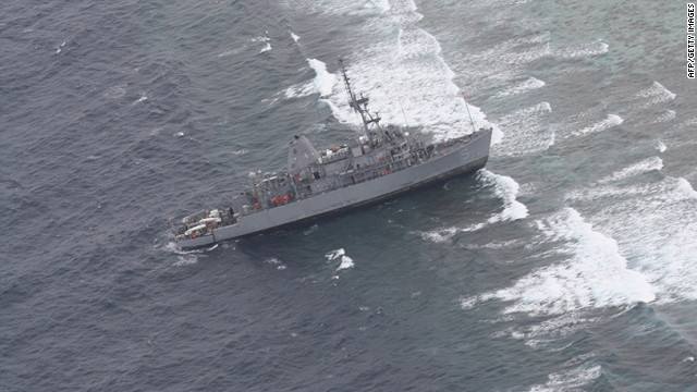 Navy ship evacuated after running aground