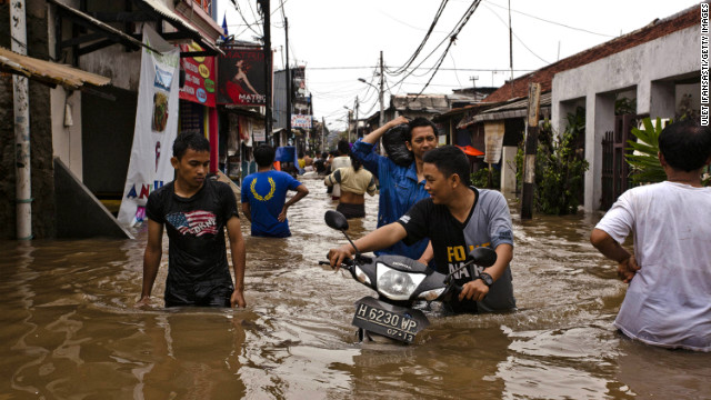 Indonesia floods kill 12; thousands flee raging waters