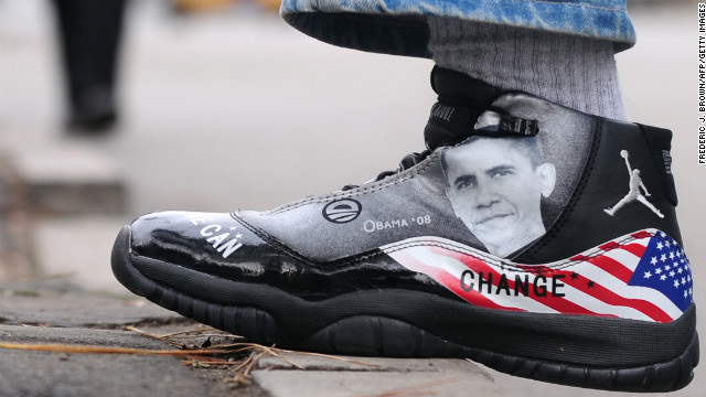 CHINA: A man wears a basketball sneaker with an image of Obama on November 11, 2009, along a street in Beijing.