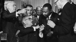 Conservatives say MLK\'s primary goal was to change hearts, not law. Here King shakes hands with President Lyndon Johnson after the signing of the 1964 Civil Rights Act.