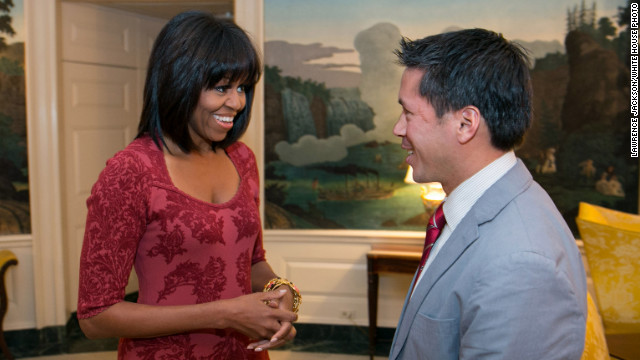 "Michelle Obama catches the American public's attention whenever she sports a new look. On Thursday, her 49th birthday, her office <a href='http://twitter.com/FLOTUS/status/291999764973756416/photo/1' target='_blank'>tweeted images of the first lady</a> with new bangs. Here she meets with inaugural ""citizen"" co-chair David Hall."