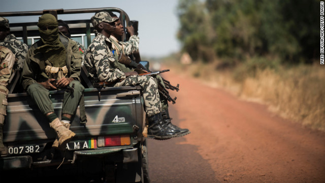 Malian soldiers sit in a truck on their way to Niono, Mali, on Friday, January 18.