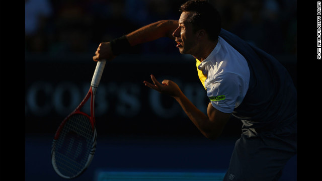 Philipp Kohlschreiber of Germany serves in his third round match against Milos Raonic of Canada.