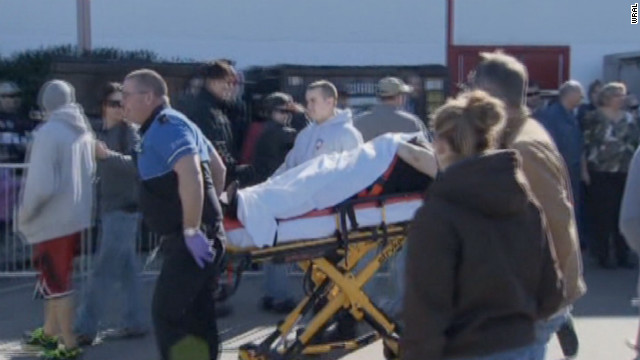 An injured person is taken from the North Carolina State Fairgrounds after being wounded in a gun accident on Saturday.