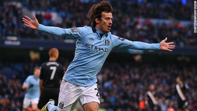 David Silva celebrates scoring the opening goal in Manchester City's 2-0 win over Fulham at the Etihad Stadium.