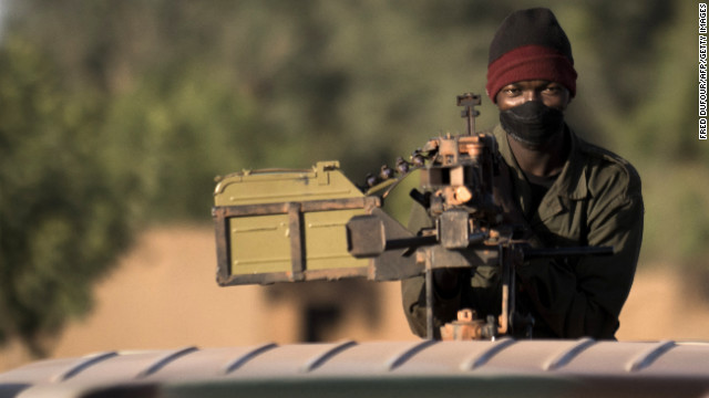 A Malian soldier holds a machine gun on top of a jeep on the road back from the town of Mopti, Mali, on Saturday, January 19. 
