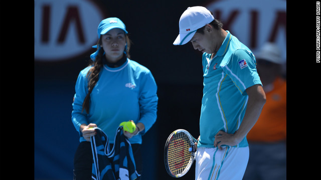 Nishikori reacts during his match against Ferrer on January 20 as a ballgirl watches.
