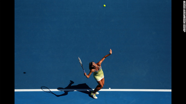 Maria Sharapova of Russia serves in her fourth-round match against Kirsten Flipkens of Belgium on January 20. Sharapova defeated Flipkens 6-1, 6-0.