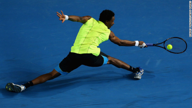 Gael Monfils of France twists around to return the ball in his third-round match against compatriot Gilles Simon on Saturday, January 19. Simon defeated Monfils 6-4, 6-4, 4-6, 1-6, 8-6.