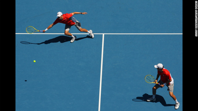 Mike Bryan of the U.S. plays a forehand in his third-round doubles match with his twin, Bob Bryan, against Jeremy Chardy of France and Lukasz Kubot of Poland on January 20. The Bryans won 6-7 (4), 6-4, 6-3.