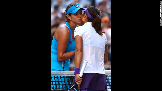 German Julia Goerges, left, congratulates Na Li of China on winning their fourth-round match 7-6 (6), 6-1 on January 20.