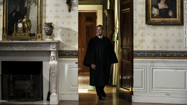 Roberts arrives to administer the oath of office to Obama at the White House on Sunday.