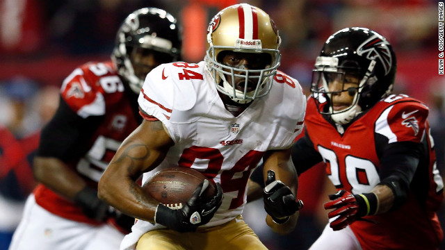 Randy Moss of the 49ers carries the ball in the third quarter against the Falcons.